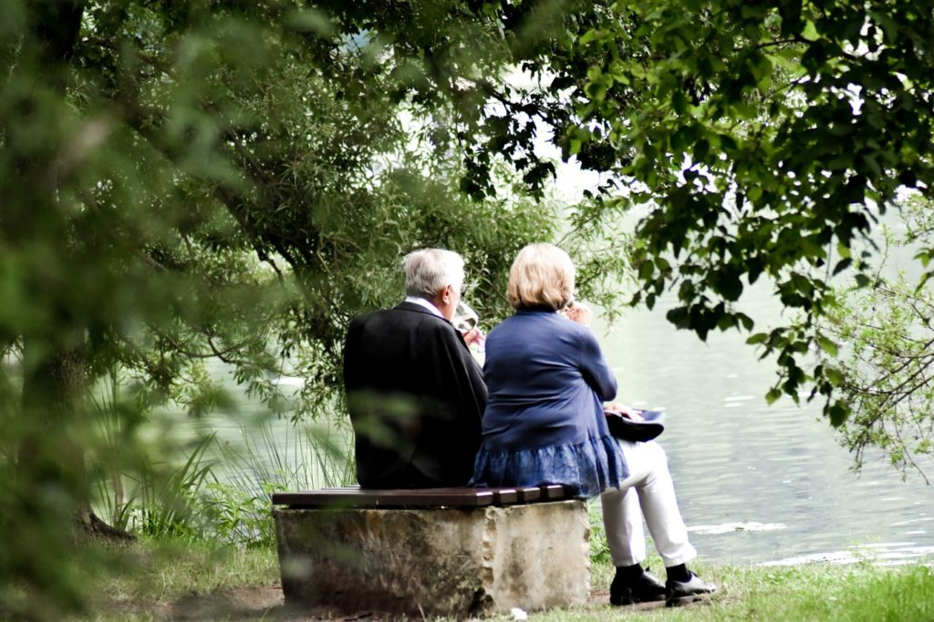 couple sitting by lake