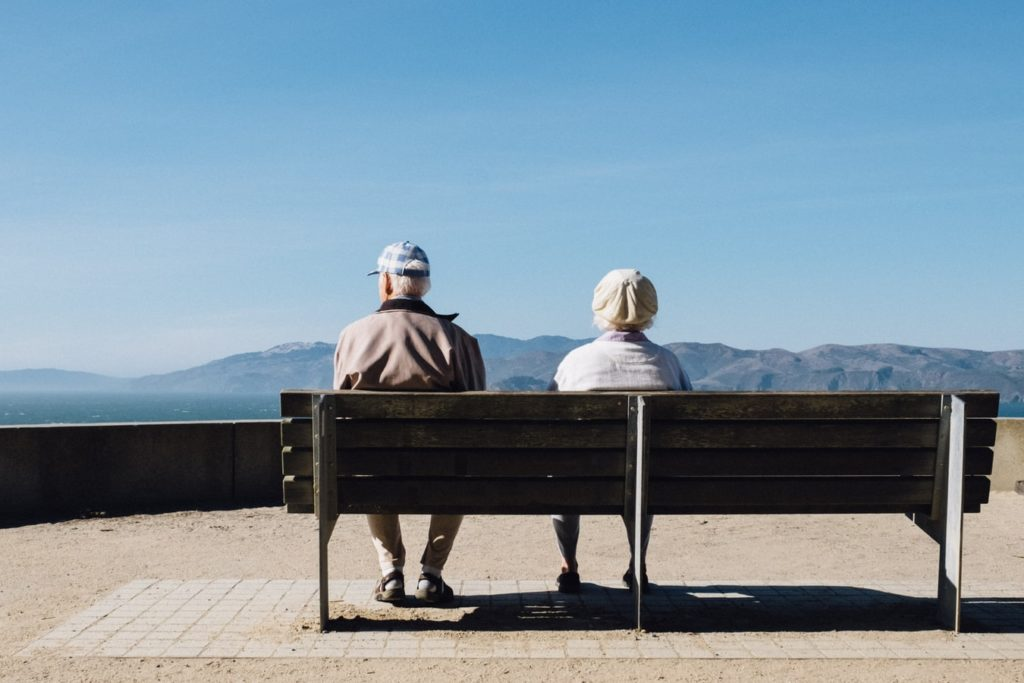 older couple bench view